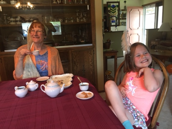 woman and girl tea party