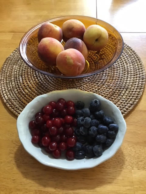 bowls with berries and peaches
