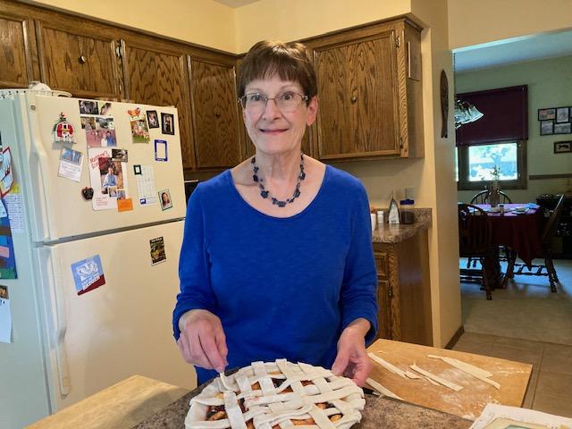 woman preparing a pie