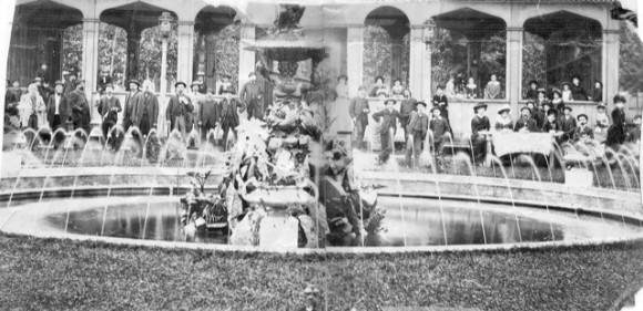 people standing around a fountain